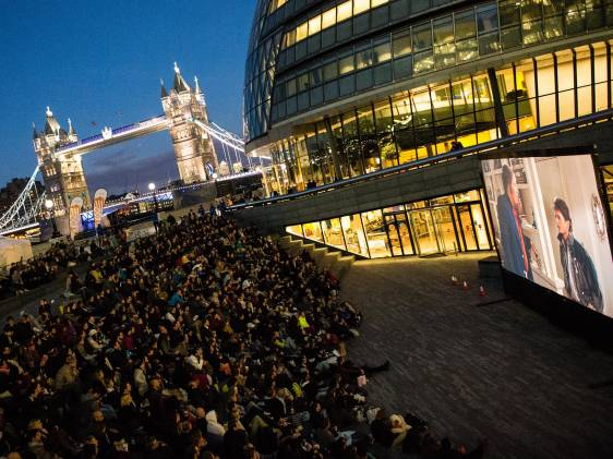 People watching an open air film screening in London
